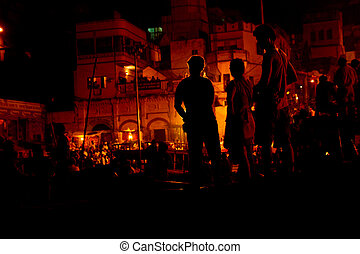Vanasi ganga Aarti - Silhouette of people looking at the...