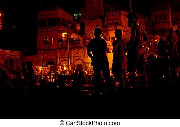 Vanasi ganga Aarti - Silhouette of people looking at the...