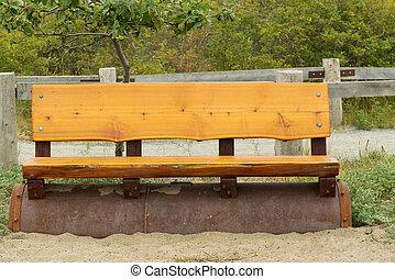 Cedar Wooden Park Bench on the Beach