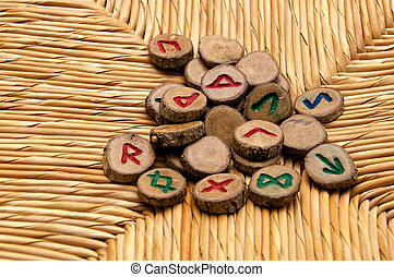 germanic Runes on wicker surface - A pile of germanic runes,...