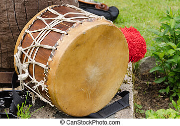 leather drum with African motifs outdoor - old leather drum...