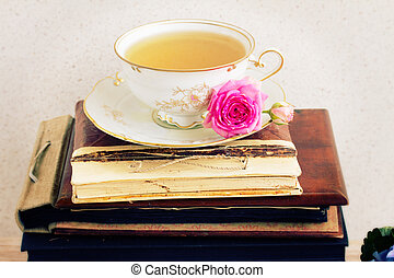 books with cup of tea - vintage books, antique cup of tea...