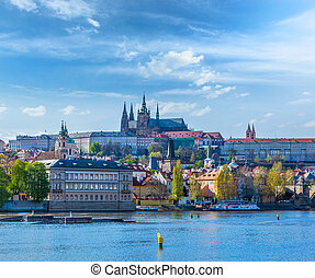 View of Charles bridge over Vltava river and Gradchany...