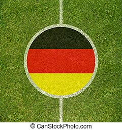 Football field center closeup with German flag in circle