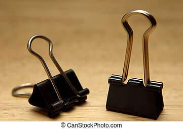 bulldog clips - closeup of bulldog clips on wooden...