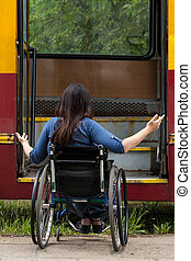 Girl on wheelchair having problem with entering the tramway...