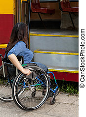 Woman of wheelchair having problem with public transport,...