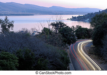 Road with light trails at Hartebeespoortdam, South Africa