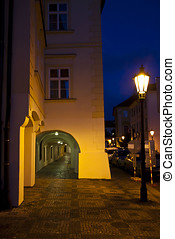 Prague at night, antique building and street lamp -...