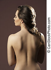 woman with bare back and hairdo - sensual brunette female...