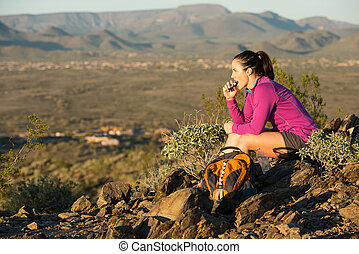 Top of the Desert Trail - Young woman pauses at the top of a...