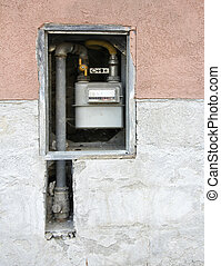 Gas meter on the wall - Pipes and gas meter on the wall of...