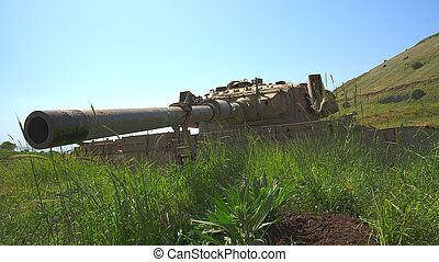 Large-caliber gun on old destroyed tank beside the Syrian...