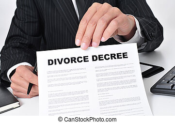 lawyer showing a divorce decree - closeup of a lawyer...