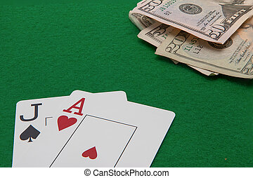 Blackjack hand with Dollar notes on