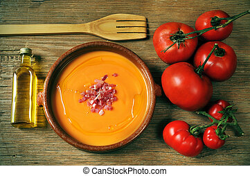 spanish salmorejo - an earthenware bowl with spanish...
