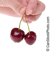 Two cherries in hand