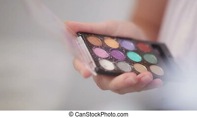 Eyeshadow Palette - Female hand holding color palette