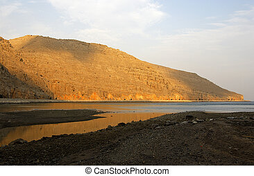 Musandam peninsula - Morning light on the bare rocks of...