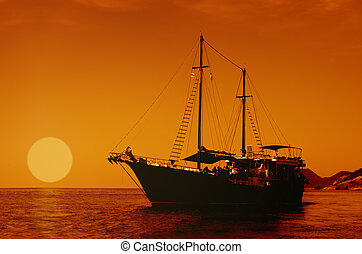 Sailing ship on the sea at sunset skyline. - Sailing ship...
