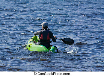 canoe - young lady canoing on lake bala in wales