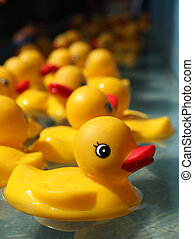 Rubber Duckies Floating in a Carnival Game Outdoors