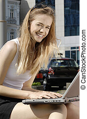 happy student with laptop