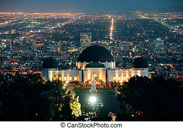 Los Angeles at night with urban buildings and Griffith...