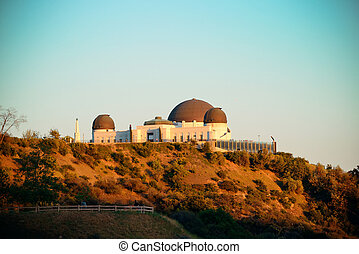 Griffith Observatory over mountain in Los Angeles