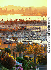 San Diego downtown skyline at sunrise with boat in harbor