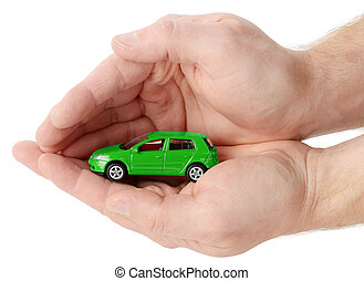 Car insurance - car in hands on a white background. Concept...