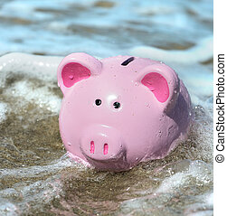 financial problems - piggy bank engulfed by water