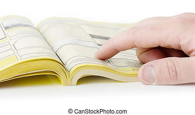 yellow pages searching with finger, blank spaces for text...
