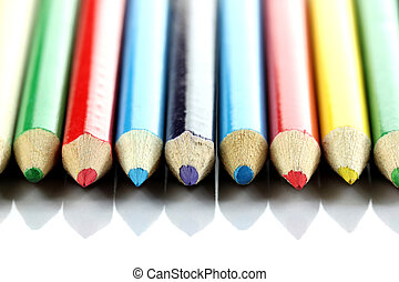 Several colored of crayon is arranged on white - Several...