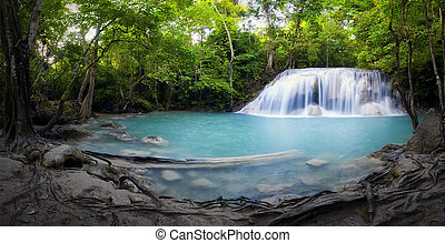 Panorama of tropical forest, waterfall and pond