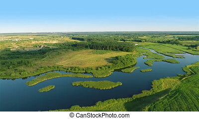 Flying over river, fields and fores - Aerial shot: Flying...