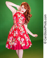 Red haired woman wearing a red summer dress - Red haired...