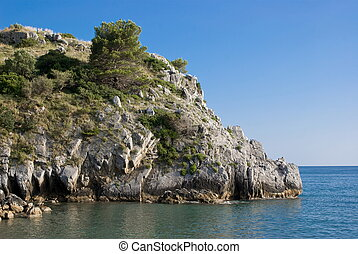 Bluff with selvatic vegetation in Mediterranean sea,...