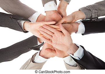 Business People Stacking Hands - Directly below shot of...