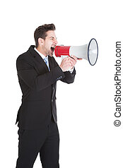 Businessman Screaming Into Megaphone - Full length of young...