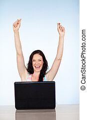 Happy woman having success with laptop - Happy young woman...
