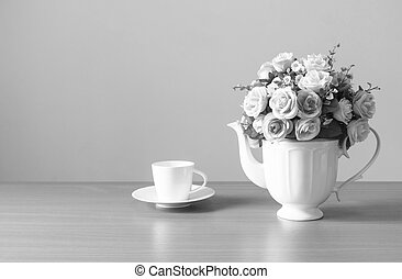 Romantic a bouquet of roses in white jug with coffee cup on...