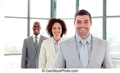 Smiling young businesswoman in a row