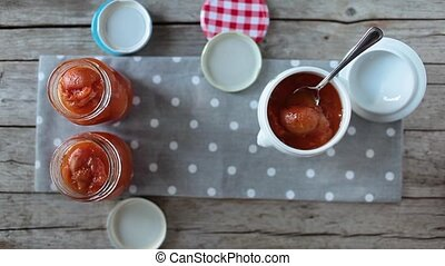 Apricots Marmalade Jars - Video clip of jars with fresh...