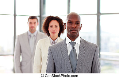 Serious African-American businessman leading his colleagues