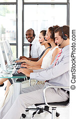 Ethnic businessman working in a call center