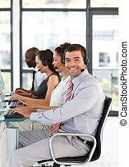 Friendly businessman working in a call center - Friendly...