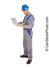 Manual Worker Using Laptop - Smiling young manual worker...