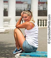 Sporty girl  - The girl in sportswear on the street