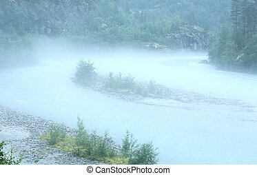 Dense fog over river.